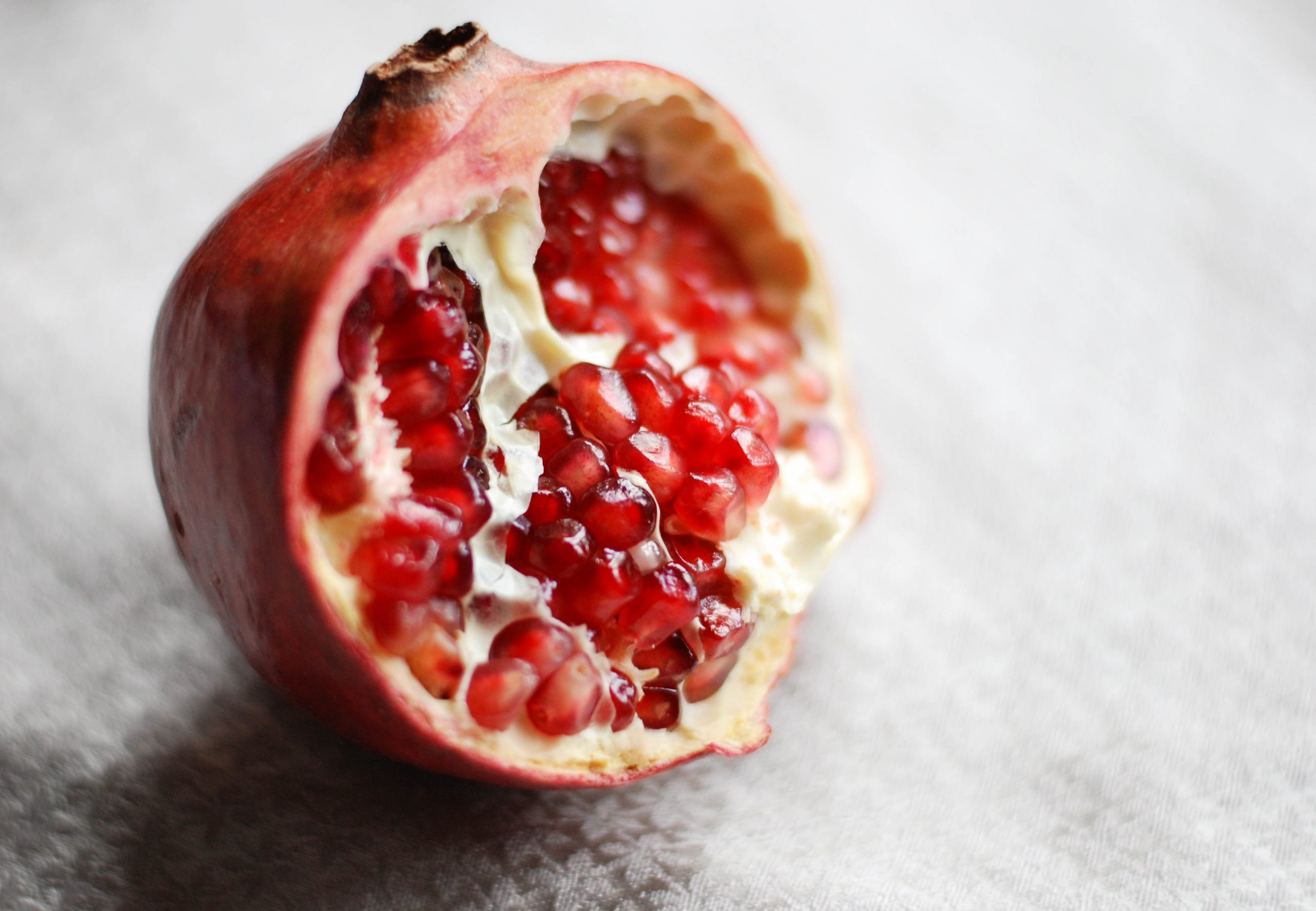 sliced orange and pomegranate fruits